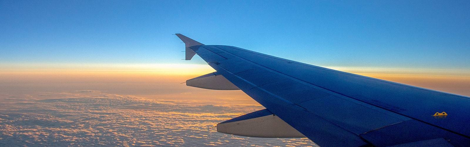 wing of an aircraft with sunset