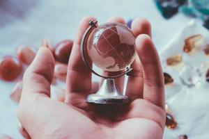 Globe in palm of hand