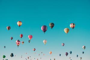 balloons floating through sky