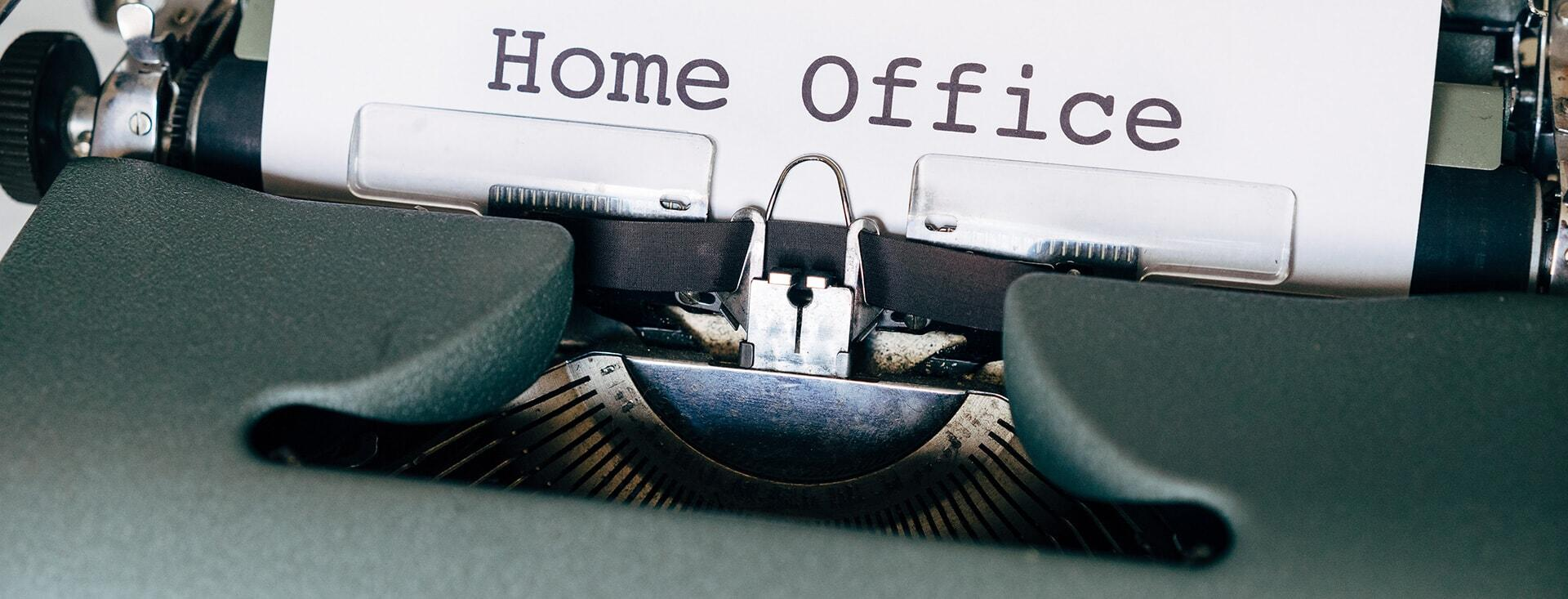 """Typewriter with words """"Home office"""" being typed"""