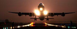 Airplane taking off at dawn